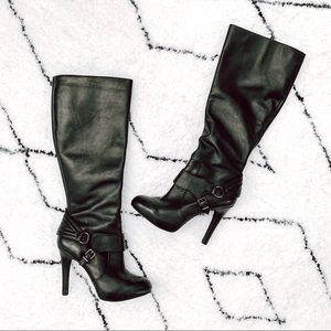 High heeled knee high black leather boots